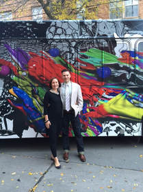 Studio Holland Art donates to arts education. Pictured: Artist Brent Holland and his wife in front of his public art project, Splatter